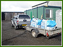 Navara & trailer delivering logs
